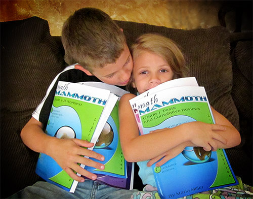 Children hugging Math Mammoth books